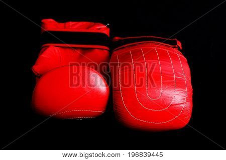 Red Leather Mittens For Boxing Lying Near Each Other