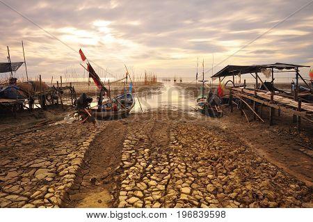 Traditional thai boats at sunrise beach, Nakhonsithammarat.