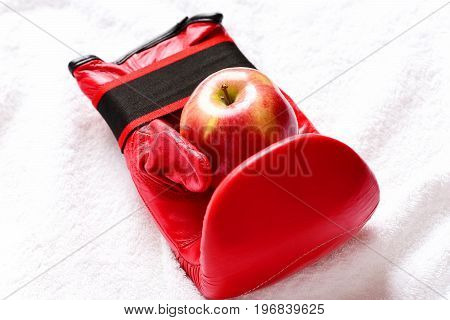 Sport Equipment And Fruit On White Towel Background, Close Up
