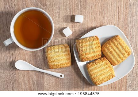 Cup of tea and shortbread cookies with jam on table for breakfast top view