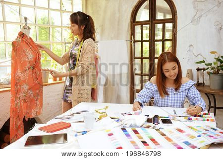 Teamwork Designer Concept : Fashion Designer Working Near Mannequin In Office