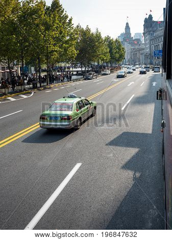 Shanghai, China - Nov 6, 2016: Along The Bund in a bus on Zhongshan Road. A taxi is beside the bus.