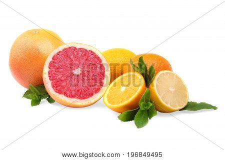 Perfect, ripe, juicy, fresh, exotic half-peeled and whole grapefruits, oranges and  lemon with bright green leaves of mint, isolated on a white background. Multi-coloured citrus fruits. Vitamins.