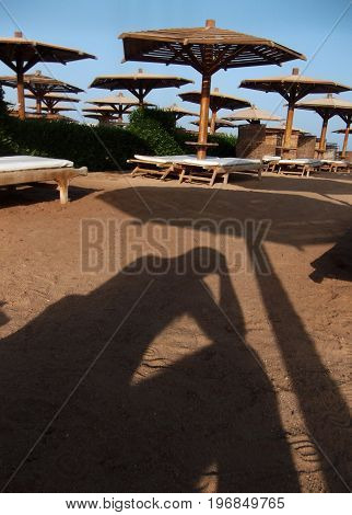 The shadow of a man who has problems on vacation. Egypt.