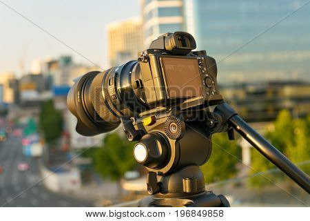 SEOUL, SOUTH KOREA -  JUNE 01, 2017: digital camera on tripod at Seoul 7017 Skypark. The Seoullo 7017 Skypark, is an elevated linear park in central Seoul  which opened on May 20, 2017.