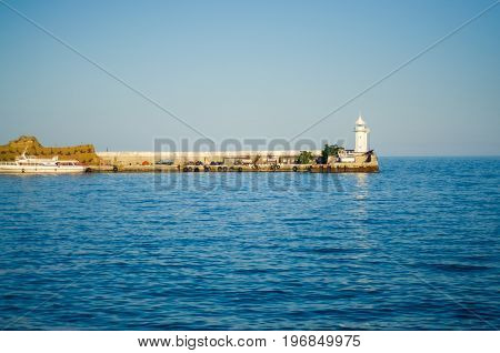 Wharf and lighthouse on the sea day nature