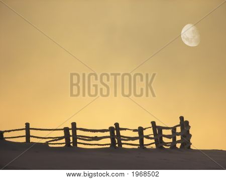 Winter Landscape With Fence And Moon