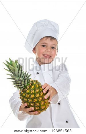 Portrait of a cute happy little chef holding pineapple on white background.