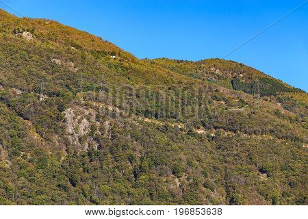 Slope of a mountain in the Swiss Alps seen at the middle of autumn from the city of Bellinzona in the Swiss canton of Ticino.