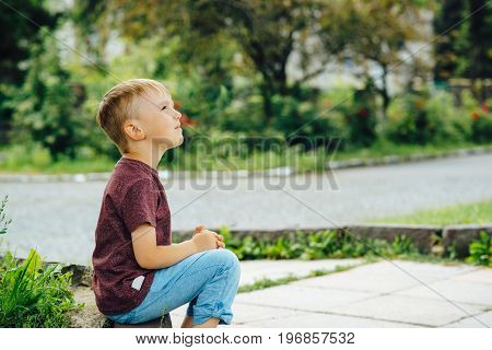 Cute Little Boy Looking Up The Sky In Sunny Day. Child Dreaming, Hope Concepts.