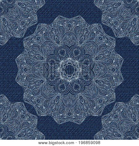 Dark blue jeans seamless texture. Denim background with mandala lace. Pattern can be used for wallpaper pattern fills web page background surface textures. Denim texture