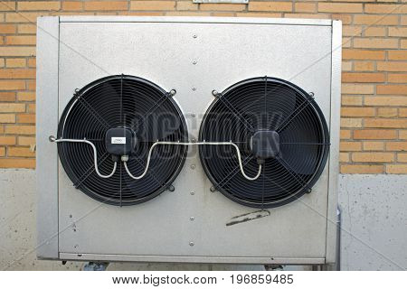 Air conditioner in front of a wall