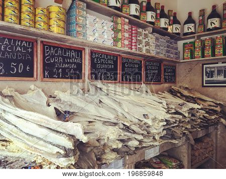 LISBON PORTUGAL - NOWEMBER 19 2016: Vintage shop with Portugese Bacalhau fish in Lisbon local product