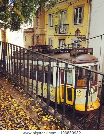 LISBON PORTUGAL - NOWEMBER 21 2016: Vintage yellow tram number 28 in Lisboa Portugal
