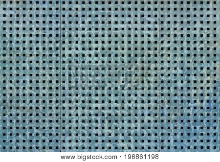 Bluish metallic background with perforation of square holes.