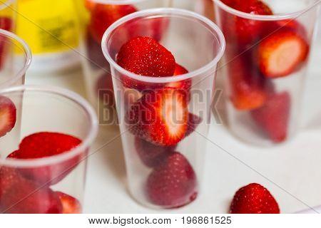 lots of strawberries in glasses prepared for break time