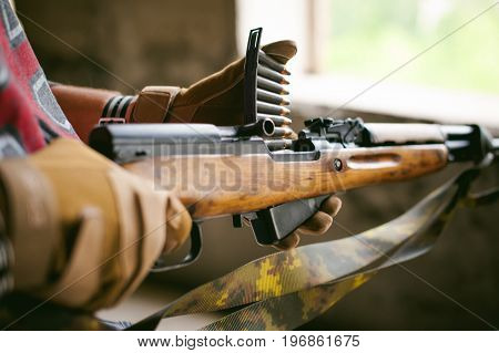 Rifle Carbine Is Weapon In Hands. Closeup Tactical Gloves  Weapons, Reloading Ammunition. Soldier On