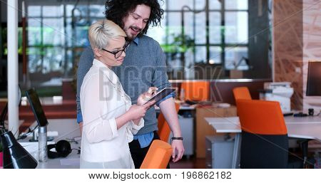 two business people using tablet  preparing for next meeting and discussing ideas