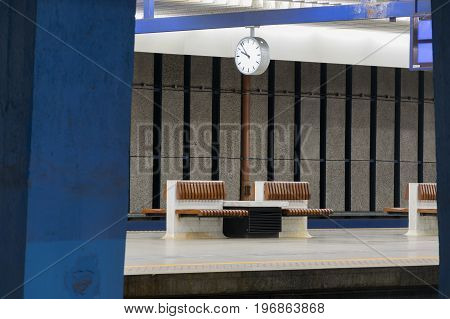 railway station with benches and clock. background for graphic design.