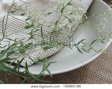 Summer flowers on matte plates with linen towel on burlap background, food photo props.