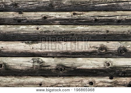 Natural brown log cabin wood wall. Wall texture background pattern. Wood planks, boards are old with a beautiful rustic look, style.