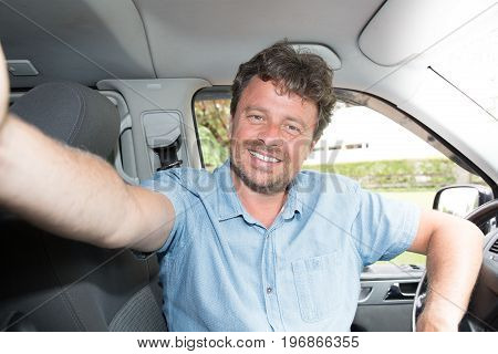 Man Driver Smiling Sitting In Driver Seat With Make A Selfie With Smartphone