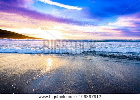 Small Ocean Sea Waves On Sandy Beach With Sunrise Sunset.