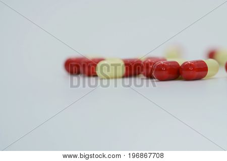 Two tone antibiotic capsule pills on white background
