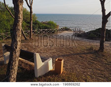 empty bench on a beautiful sea wiew in golden evening light