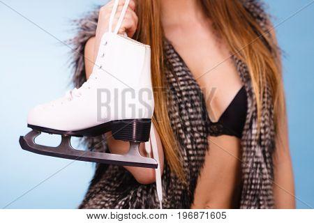 Sexy Woman Holding Ice Skates