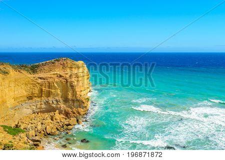 Tourists enjoying the view at the edge of Castle Rock Twelve Apostles Victoria Australia