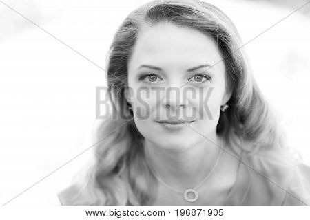 headshot of beautiful woman outdoor in a sunlight black and white