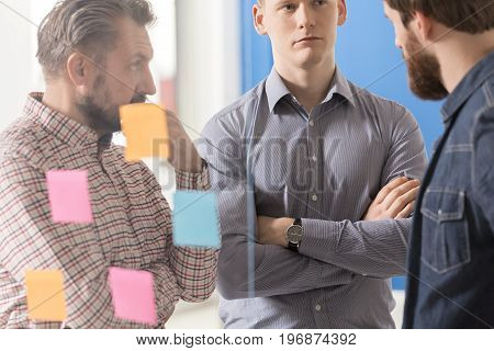 Group of employees paying attention to what their colleague says