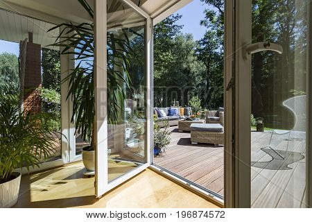 Open hause terrace entry with the view of the veranda in a sunny day
