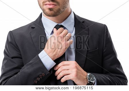 Cropped Shot Of Businessman In Formal Wear Tying Necktie Isolated On White