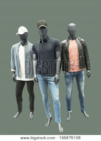 Three man mannequins dressed in casual clothes isolated. No brand names or copyright objects.