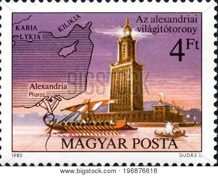 UKRAINE - CIRCA 2017: A postage stamp printed in Hungary shows Pharos Lighthouse Alexandria from series Seven Wonders of the Ancient World circa 1980