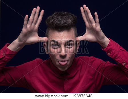 Funny Face, Funny Expression, One Teenager Boy, Tongue Out, Hands Next To Face, Looking At Camera, R