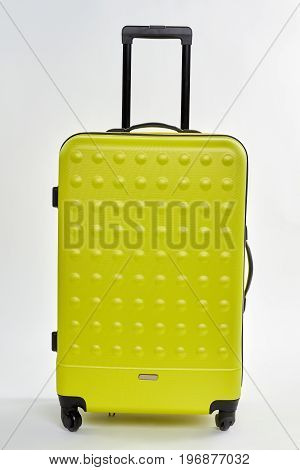 Suitcase with handle for traveler. Large valise on wheels isolated on white. Time for travel.