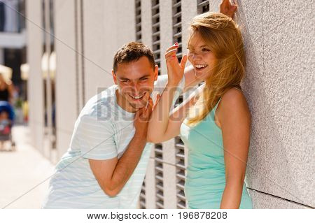 Flirt love and passion concept. Man flirting with attractive blone girl on city street.