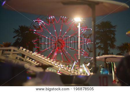 Ferris Wheel Behind The Rides