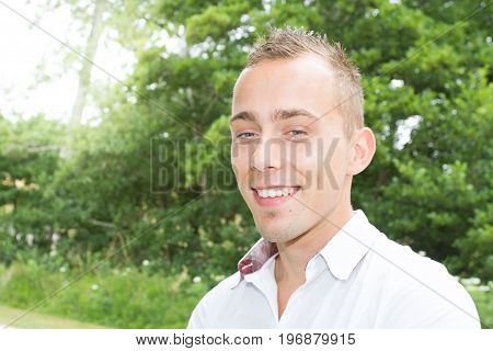 Portrait Of Handsome 30-year-old Man Outdoors Home