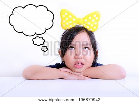 Picture of little girl day dreaming with bubble for caption