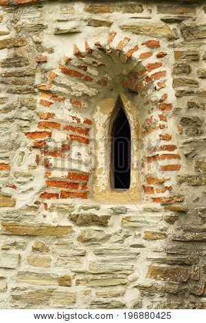 gothic church window detail on old abandoned historical building