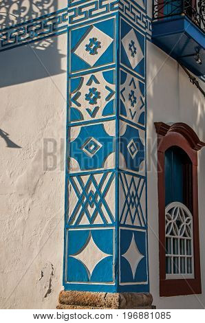 Close-up of the colorful wall decoration of old house at the sunset in Paraty, an amazing and historic town totally preserved in the coast of the Rio de Janeiro State, southwestern Brazil