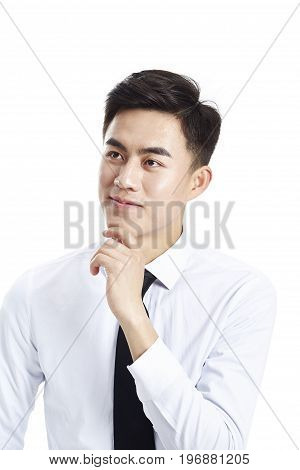 studio portrait of a young asian businessman wearing shirt and tie hand on chin isolated on white background.
