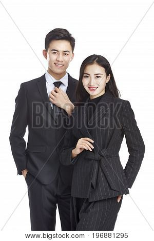 studio portrait of young asian business man and woman looking at camera smiling isolated on white background.