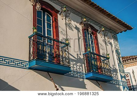 Close-up of elaborate old house balcony decoration at the sunset in Paraty, an amazing and historic town totally preserved in the coast of the Rio de Janeiro State, southwestern Brazil