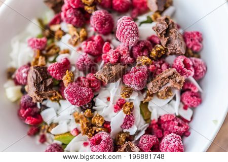 Dark Pink Raspberries In Bowl With Chocolate, Chopped Figs And Fruit