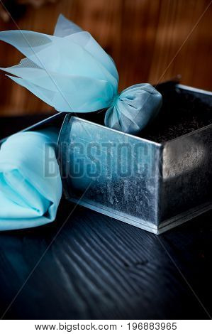 silk tea bag. Next tin with a large leaf black tea. The emergence of the tea tradition
